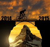 Cyclist  at sunset. Forward to the New Year 2015