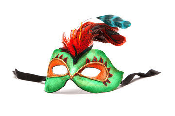 Green Mardi Gras Mask with feathers on white background with bla