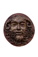 Bas-relief Faunus  of the Greek deity made on wood isolated on w