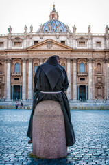 Friar view basilica of st. Peter's in Rome