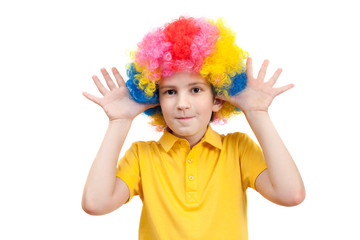 the boy in the carnival clown wig