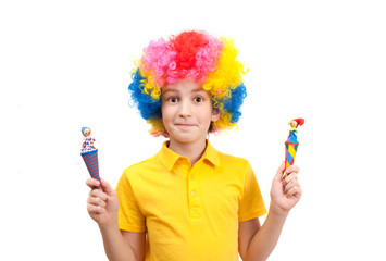 funny boy wears colorful wig holding a wooden clowns