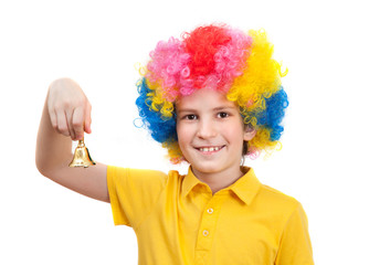 Nice kid wears colorful wig and calls by hand bell