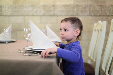 Boy in restaurant