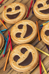 Round smiling chocolate cookies with colour confeti