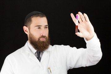 Jewish bearded doctor holding test tube.