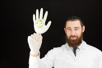 Bearded doctor holding inflated glove.