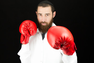 Bearded doctor wearing red boxing gloves.