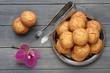 Almond cookies with sugar tongs and orchid flower