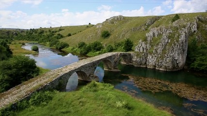 Mountain river with medie val bridge in Bosnia