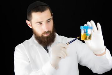 Bearded doctor holding test tube.