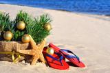 Christmas tree with christmas balls, slippers and starfish on th