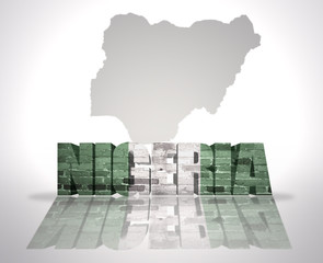 Word Nigeria on a map background