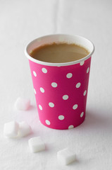 Coffee in a pink paper cup