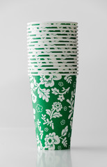 Green paper cup with flowers pattern