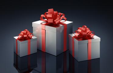 3 Geschenke vor dunklem Hintergrund