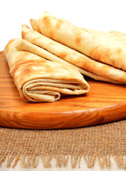 Lavash, tortilla wrap Bread on the cutting board isolated