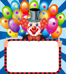 merry clown with balloons holding a poster