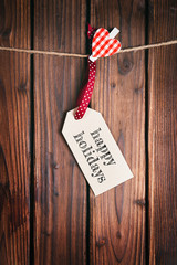 Merry Christmas tag on wooden surface