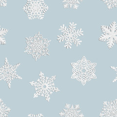 Seamless background of home-made paper snowflakes.