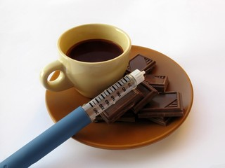 diabetes syringe and chocolate and hot chocolate