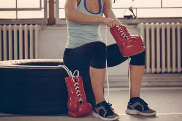Female Boxer Preparing For Training