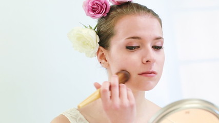Young woman apply her makeup