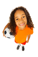 Black girl with soccer ball view from above