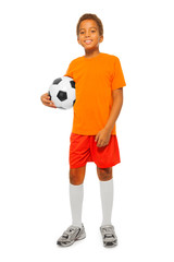 Little African boy holding soccer ball isolated