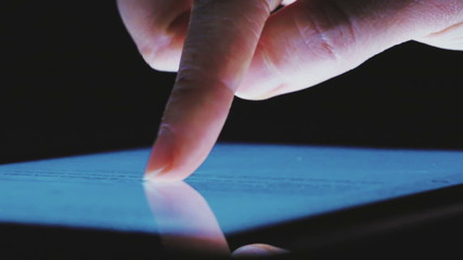 Closeup of woman using tablet computer touchscreen.