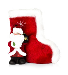 Santa Claus and Christmas boots isolated on white background