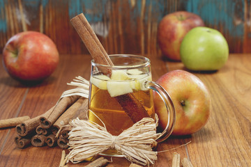 Apple cider and apples on rustic wood.   Winter drink