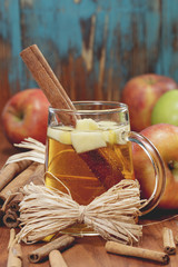 Apple cider and apples on rustic wood.   Winter drink.