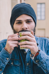 Portrait man - Hipster drinking from a cup