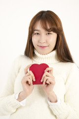 SSmiling young asian woman with red heart shape