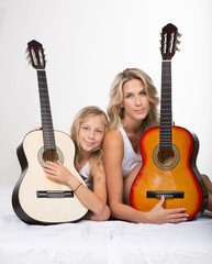 Mother and daughter with guitar together