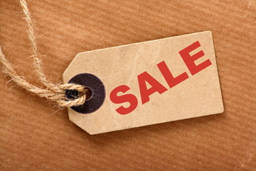 Sale announcement message on a paper tag