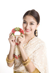 Young Thai lady in traditional costume holding garland isolated