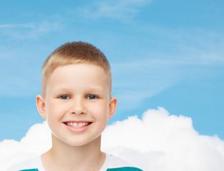 smiling little boy over green background