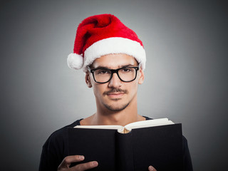Portrait of young man wearing Santa's hat