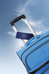 Kiev, Ukraine. Blue suitcase with label