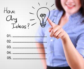 business woman designate a lamp of idea