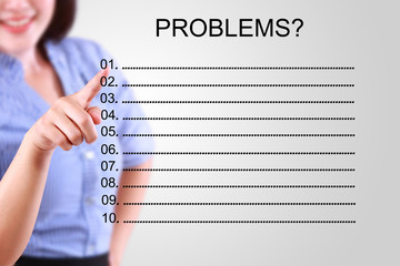 business woman pointing problem list