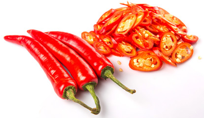Cut slices of red chili pepper on white background