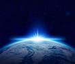 Leinwanddruck Bild - World, Blue Planet Earth sunrise over cloudy ocean in space
