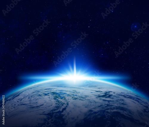 Leinwanddruck Bild World, Blue Planet Earth sunrise over cloudy ocean in space