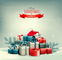 Holiday Christmas background with gift boxes and a santa hat. Ve