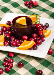 Jellied cranberry sauce with orange wedges and rosemary