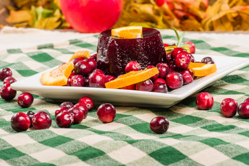 Whole cranberries and plate with cranberry sauce