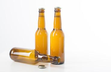 Three brown beer bottles .